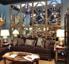 Create a dramatic backdrop for your living room with a wall of mirrors. | Houston, TX | Gallery Furniture |