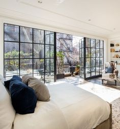 At billionaire Rupert Murdoch's West Village townhouse, glass-paneled French doors lead from a bedroom onto the terrace. | archdigest.com