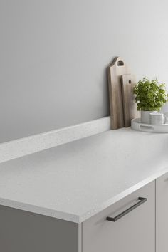Looking for white countertops ideas? Our Howdens White Sparkle Quartz Effect Laminate Worktop looks amazing when paired with a grey slab kitchen and black kitchen hardware. These white sparkle quartz effect kitchen countertops are affordable and are perfect for creating texture in your modern kitchen design. Howdens Worktops, Kitchen Worktops, White Countertops, Kitchen Hardware, Light And Space, Work Surface, Work Tops, Black Kitchens, White Quartz