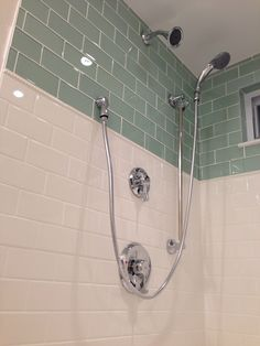 Glass subway tile. Dotted pencil tile. American Olean white subway tile. DIY walk in shower. Commercial Moen shower head with slidebar and handheld shower