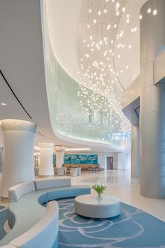A water theme is incorporated into the interior materials, lighting, and art selection, as shown in the double-height main lobby, to symbolize purity, healing, and fertility. Credit: Michael Stavaridis Photography
