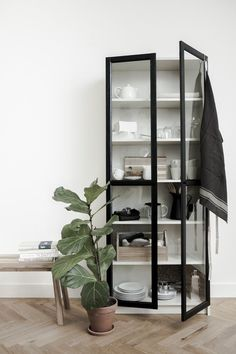 IKEA Billy Bookcase hack - We're all about the less-is-more approach with this one, which entails a seemingly plain white bookcase paired with an ingeniously simple add-on: a pair of glass doors. The result? A style-focused take on a modern cabinet that's Billy Ikea Hack, Ikea Billy Bookcase Hack, Billy Bookcases, Billy Bookcase With Doors, Bookcase White, Ikea Furniture, Shabby Chic Furniture, Modular Furniture, Living Room Ideas