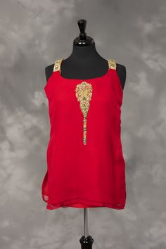 Red chiffon with gold embroidery and stones.