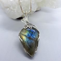 Blue and green Labradorite wrapped in sterling silver filled wire