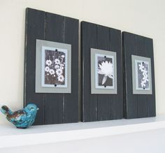 The simplicity is great and this can be done from leftover project wood, paint, some pretty paper backing, and the adorable photos that you take and don't really know how to display.
