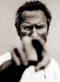Anton Corbijn // harsh contrast // creative loss of detail (eyes, shirt) // moderate depth of field (face in focus, everything else blurry) // main focus of image (face) obscured by hand //