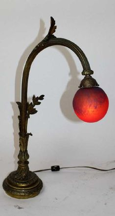 Lot: French bronze table lamp with Art de France shade, Lot Number: 0115, Starting Bid: $150, Auctioneer: King Galleries, Auction: Fine Art, Antiques & Collectibles Auction , Date: February 25th, 2017 EST