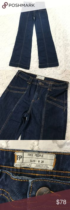 """RARE Free People High Rise Bell Bottom Jeans 28 Perfect condition, these have hardly been worn at all.  Dark wash, with sun Burst Stitching on butt.  The last pic is a stock photo so you can see how they fit, but clearly in a different color.  These look AMAZING on your butt!  These are very stretchy. Waist measures 15"""" across Lying flat. Front rise is almost 10"""" , 33"""" inseam.  You will LOVE LOVE LOVE these jeans!! Free People Jeans Flare & Wide Leg"""