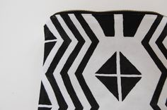 Tutorial: Geometric Print Clutch~  Materials: White canvas zippered pouch/clutch, black acrylic craft paint, textile medium, paint brushes, ruler, pencil, iron.