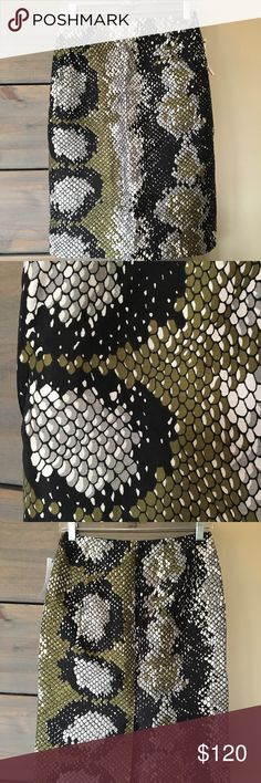 Prada Pencil Skirt Snakeskin Print Size 42. PLEASE NOTE MEASUREMENTS before purchase (as I don't know if dress has been altered or tailored). Purchased from The RealReal (tags still attached).  I've never worn it. In like new condition. Some wayward threads in stitching I've noticed but does not affect integrity of skirt (see photos).    Laid flat (measures approximate): 13.5 in at waist, 24 in length.   56% wool, 44% silk, lining is 66% viscose and 34% silk Prada Skirts Pencil
