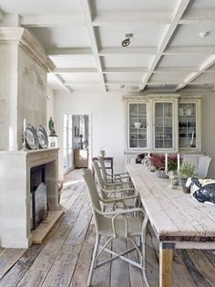 love the rustic whitewashed feel to this room
