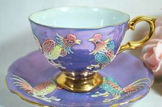 Rare vintage tea cup and saucer hand painted roosters .Moriage purple and gold with mother of pearl varnish outside