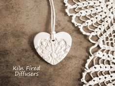 Unglazed, Lace Imprinted white ceramic (kiln fired) heart, embellishments / pendants / ornaments to paint or leave unfinished, its up to you. When left unpainted they can be used as aromatherapy essential oil diffusers. They can be gift tags, necklaces, table decoration etc.  These romantic white hearts make fantastic, unique, original and pleasant bridesmaid jewelry that the individuals may customize by their own essential oils or leave unscented.  They are very light weight. Size about 1.5…