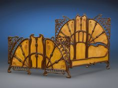 magnificent art nouveau cast iron bed interspersed with wood panels that are inlaid with mother of pearl - 1900
