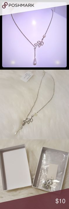 """NWT Pearl Leaf Silver Lariat Necklace Charming and elegant silver necklace from Woman Within! This necklace has a leaf design with pearl accents and is adjustable. 18"""" long, not including extender. Perfect for accessorizing dressy outfits!  Discount on 2+ item bundles! :-) Woman Within Jewelry Necklaces"""