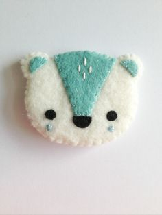 Handmade snow bear brooch. Made using 100% merino wool blend felts and beautifully hand-stitched using my own original pattern.    Bear measures approx