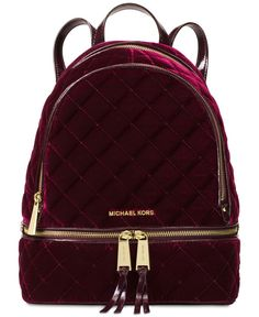 "Crafted from ultra-soft quilted velvet, Michael Michael Kors' Rhea backpack offers a feminine spin on utilitarian cool. | Rayon; lining: polyester | Imported | 9""W x 13""H x 5""D 