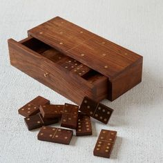 This Domino Box Set makes a great gift or party accessory this holiday season. It's a product of an inlay tradition which stretches back centuries, and is crafted by Indian artisans who hand inlay brass into solid sheesham wood.