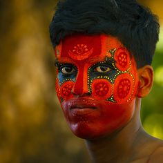 Man With Traditional Makeup On His Face For Theyyam Ceremony, Thalassery, India by Eric Lafforgue, via Flickr