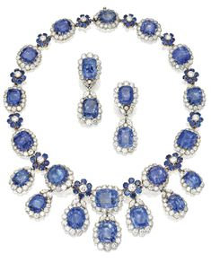 GOLD, SAPPHIRE AND DIAMOND NECKLACE AND EARCLIPS, VAN CLEEF & ARPELS, CIRCA 1960. Sotheby's.