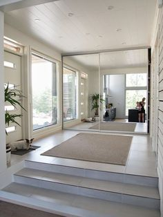 Again, light colors and highly reflective surfaces are a great way to increase lighting indirectly. the mirror wall/closest gives the implication that the space is much larger because it reflects the space and lighting. Cozy Living, Home And Living, Home Interior Design, Interior Architecture, Dream Decor, Dream Rooms, Home Improvement Projects, My Dream Home, Living Room Decor