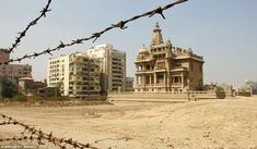 Deserted: The abandoned palace of Baron Empain sits surrounded by barbed wire in Cairo, Egypt suburb of Heliopolis.