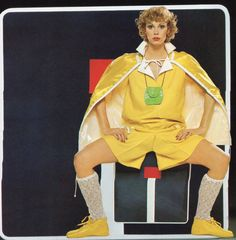 Courreges haute couture- 1977 Yellow cape, satin blouse and shorts ensemble. L'officiel USA Summer Issue 1977