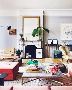 Décor Inspiration: Jenna Lyons's SoHo Loft - Milo Baughman sofa covered in pink velvet, marble, chandeliers and chevron floors ...