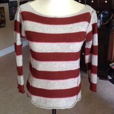 Free People boat neck sweater Maroon, taupe and pink stripe sweater....very soft....I bought used and believe it was shrunk so it would be more a small/medium fit.   (Tag says large though) Free People Sweaters Crew & Scoop Necks