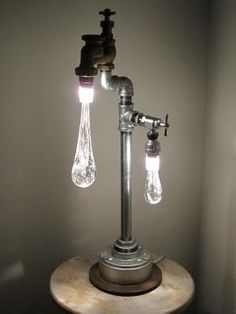 Liquid Lights - recycled plumbing pieces with hand sculpted glass drops & lit with LED's