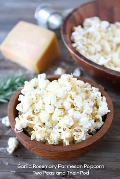Garlic Rosemary Parmesan Popcorn from www.twopeasandtheirpod.com. Loved it!!  I used microwave popcorn, drizzled with olive oil, used parmesean, Replaced rosemary with oregano and added 1/4 cup feta. Yum!!  Great snack for evenings or parties.