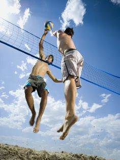Jumping volleyball players