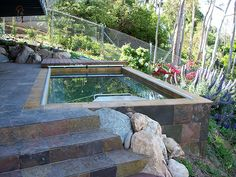 Turn even the smallest backyard into an oasis with an Endless Pool. Small Backyard Pools available of all sizes available. Sloped Yard, Sloped Backyard, Small Backyard Pools, Small Pools, Backyard Ideas, Swimming Pools Backyard, Lap Pools, Outside Pool, Cool Pools