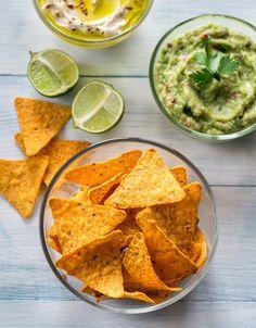 Bowls of hummus and guacamole with tortilla chips Tortilla Chips, Crepes, Finger Foods, Guacamole, Hummus, Crisp, Picnic, Gluten Free, Snacks