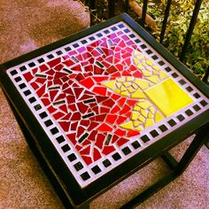 Mosaic Tile Table - I wouldn't use the one full yellow tile, but like this otherwise.
