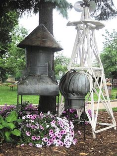 Garden art.  Yup went to an auction to buy these, they had both styles of barn vents and 9 in total. OMG they sold for $45 each.   There goes that wish. Anyone want to get rid of one or two-not at that price!
