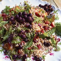 Chewy farro -- an Italian whole grain -- is tossed with mixed greens in this colorful salad. It's flavored by two kinds of grapes that have been baked in a low oven to concentrate their sweetness and release their juices. The Concord grapes aren't seedless, but they make a beautiful garnish.