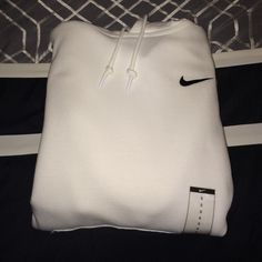 All-White Nike Hoodie Brand new with tags. Makes an excellent Christmas gift! PLEASE NOTE* This is a men's small which can fit a women's small-medium-plus, depending how you like to wear your hoodies. PRICE IS FIRM. No trades or Paypal. Nike Tops Sweatshirts & Hoodies