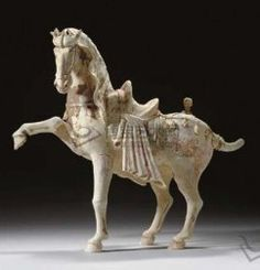 TANG DYNASTY (618-907) A LARGE PAINTED POTTERY FIGURE OF A PRANCING HORSE