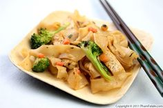 chow fun noodles with shiitake mushrooms and broccoli. mmmmmmmm.