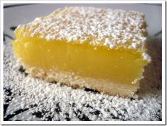 amazing lemon bars! simple and delicious and lemony! i 2/3 the recipe (except the lemon juice and zest, for which i used the full amount...i wanted them REALLY lemony) and baked it in a 9x13 pan and it was perfect!...baked for about 27 minutes (?) because i happened to check on them, and they were definitely done