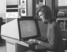 User operating a Tektronix 4014 storage tube, ca. 1970s.