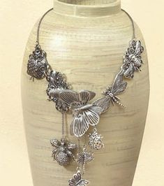 Antique silver charm necklace design - too cute!