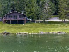 Peaceful waterfront setting with rare low bank frontage! Grass to the water's edge with private dock. Hope Peninsula waterfront home with easy seller terms. Very usable level waterfront property with rip-rap stabilized shoreline on the south side of Ellisport Bay on the Hope Peninsula. Cute two bedroom one bath cozy home with newer appliances and large deck for enjoying the spectacular Mountain and Lake views. Home is very well constructed but needs some updating.