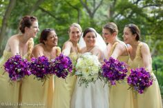 Yellow Bridesmaids dresses, purple bouquets