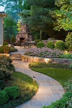Traditional Landscape/Yard with exterior stone floors, Pathway, Outdoor kitchen, outdoor pizza oven, Raised beds