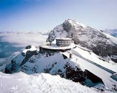 Mt Pilatus Near the lakeside city of Lucerne stands Mt. Pilatus, a 2,120-meter-tall mountain. Tourists can take a cable car to reach its top and enjoy the thrilling view. It is also a great venue for walking with numerous trails, and the visitors here can witness the spectacular scenery of the Swiss Alps.