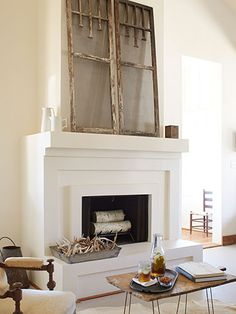 Simple fireplace with salvage accessories as art.
