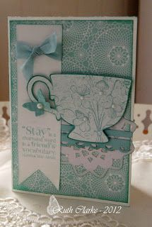Sew N Ink blog: Tea Shoppe ~ emboss the flowers with clear embossing powder to give them a nice glaze feel. emboss the tea cup in white embossing powder.
