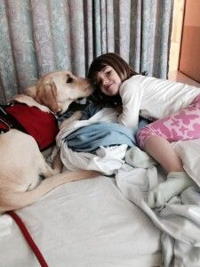 Mabel and Riley are Pawsitive Service Dog Solutions newest graduated #Autism Service Dog team and here, just a couple of days after being placed with her girl, Mabel soothes/supports Riley in the hospital.